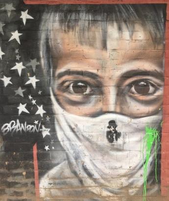 Boy with Mask Street Art - Southwark